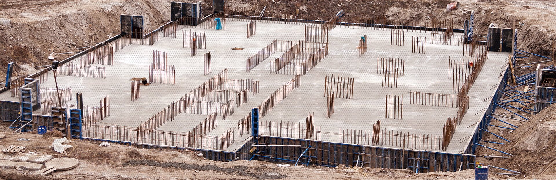 An AM Contracting job that has many footings in place for more structures to be built on top of the freshly dried concrete foundation structure.