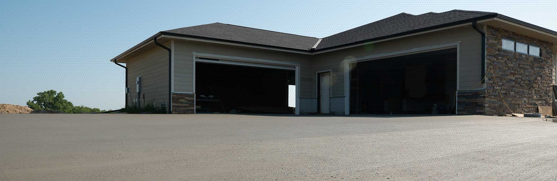 A residential home with a brand new driveway.